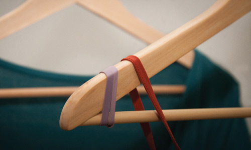 rubber band on the ends of your hangers