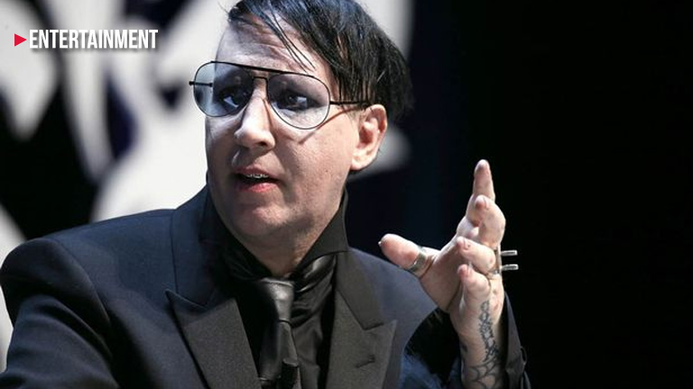 Marilyn Manson interrupts journalist and 'flicks his testicles'